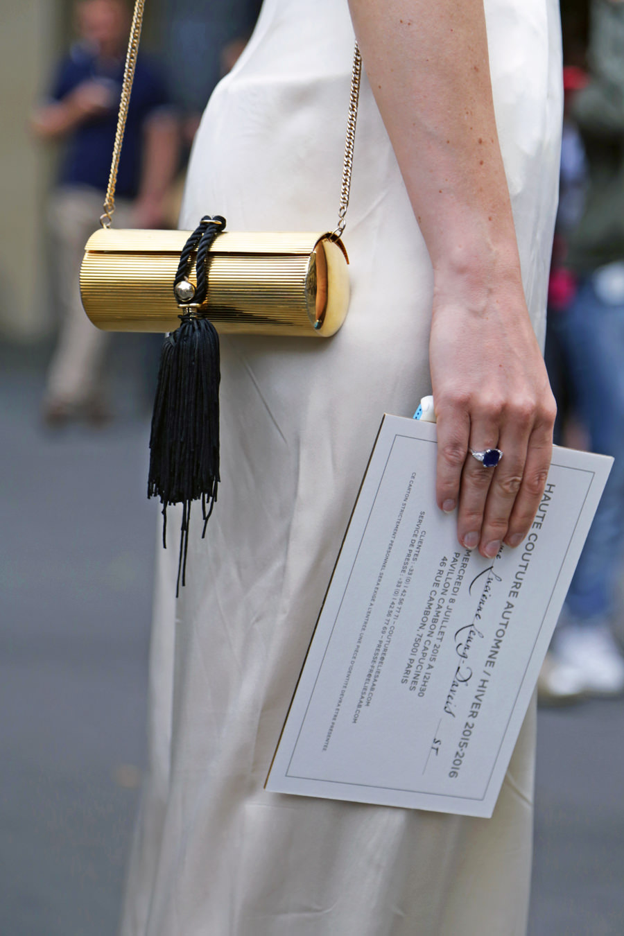 gold-purse-with-black-tassel