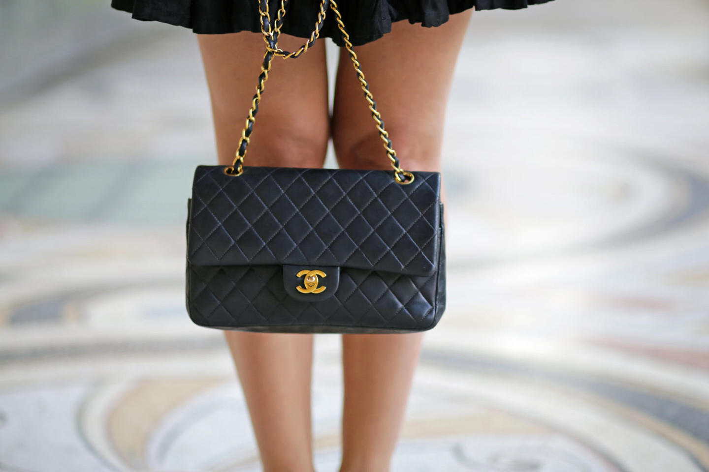 black chanel classic vintage bag with gold details